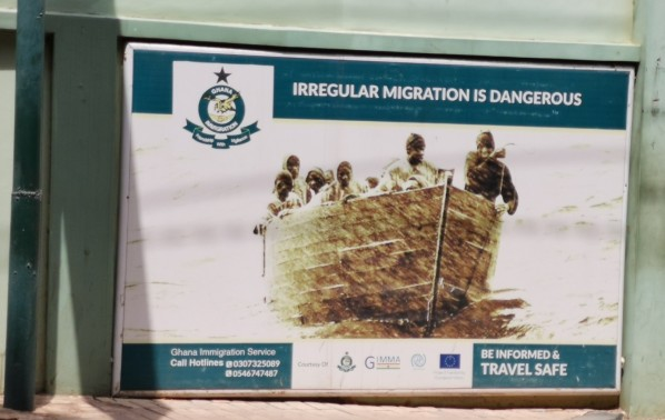 Poster on the external wall of the Ghana Immigration Service.
