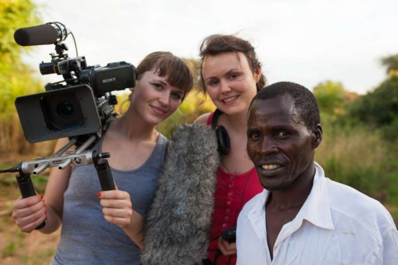 Two female filmmakers next to a man