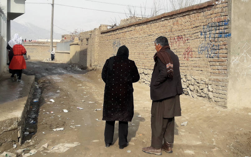 Field researchers identify a sampling starting point for survey pilot in Kabul, Afghanistan.