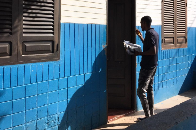 A field researcher knocks on a door.
